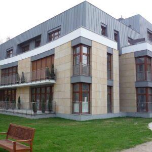 Poznań ul.Libelta budynek mieszkalny elewacja z kamienia